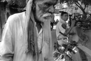 Sufi saint in a deep thought on the street