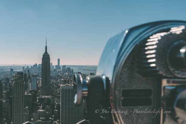 Using the city in the background to balance out the viewfinder in the foreground. The tiny viewfinder (in relation to the city) required the entire city of NY to balance the image.